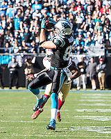 The Carolina Panthers played the San Francisco 49ers at Bank of America Stadium in Charlotte, NC in the NFC divisional playoffs on January 12, 2014.Carolina Panthers tight end Greg Olsen (88) catches a pass over San Francisco 49ers defensive back Perrish Cox (20).