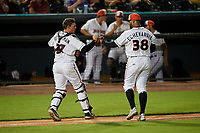 Delmarva Shorebirds catcher Adley Rutschman (37) fist bumps relief pitcher Juan Echevarria (38) during a South Atlantic League game against the Greensboro Grasshoppers on August 21, 2019 at Arthur W. Perdue Stadium in Salisbury, Maryland.  Delmarva defeated Greensboro 1-0.  (Mike Janes/Four Seam Images)
