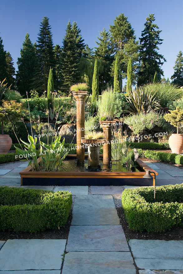 After a visit to Tuscany, a Seattle homeowner recognized the similarity of cool but mild winters and warm, dry summers between the two areas.  She returned home to install a Tuscan-themed, Mediterranean style garden around her mid-century home with hilltop views of the distant lake and mountains beyond.  In addition, her location backs to a golf course and so offers a borrowed landscape of rolling green hills without having to tend or irrigate them. Garden design by Sue Tong