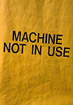 Machine Not In Use sign on yellow