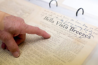 NWA Democrat-Gazette/CHARLIE KAIJO Xyta Lucas, president of the Bella Vista historical society, points at a news print from the Bella Vista Breezes owned by C.A. Linebarger, Sunday, April 15, 2018 at the Bella Vista Historical Museum in Bella Vista. Linebarger operated the paper through the early 20th century and published the poems of poet laureate of Bella Vista, Henry Coffin Fellow. Linebarger also operated a summer resort in Bella Vista where Fellow and his wife would stay when he was not working as a professor in Wichita, Kansas.<br />