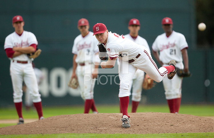 STANFORD, CA - March 27, 2011: Chris Reed of Stanford baseball warms up before relieving while his infield watches during Stanford's game against Long Beach State at Sunken Diamond. Stanford won 6-5.