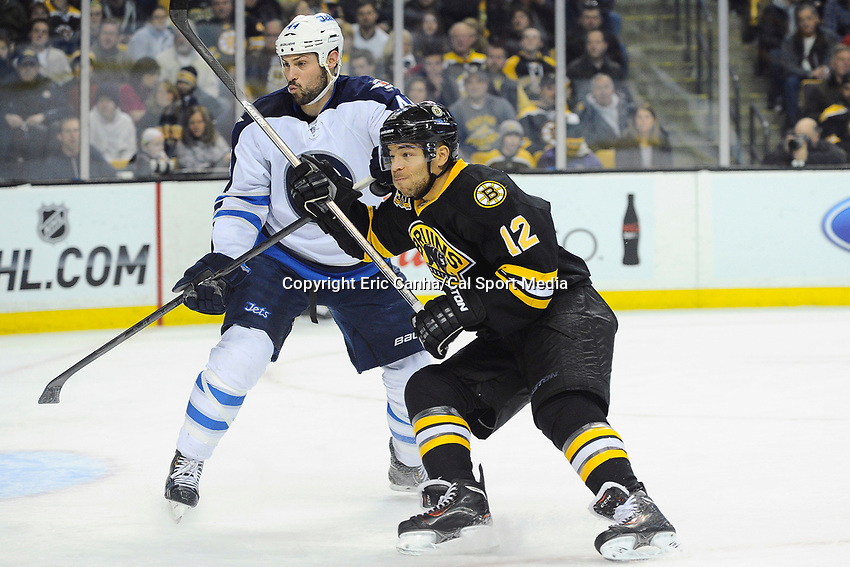 January 2, 2014 - Boston, Massachusetts, U.S. - Boston Bruins right wing Jarome Iginla (12) an Winnipeg Jets defenseman Zach Bogosian (44) in game action during the NHL game between Winnipeg Jets and the Boston Bruins held at TD Garden in Boston Massachusetts.  Boston defeated Winnipeg 4-1 in regulation. Eric Canha/CSM
