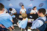 NEW YORK, NY - Tuesday June 23, 2015: Members of the MLS squad New York City FC sign autographs for fans at the adidas Sport Performance Store near Soho in New York City.