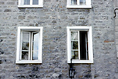 windows on an old stone house in old Montreal