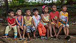 Children in Mt. Heights, Philippines, sit and listen to Maria Jessica Cicillo, a deaconess who works as a Christian educator for a nearby United Methodist Church.