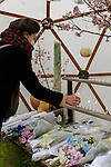 A woman leaves a candle during the fifth anniversary of the Great East Japan Earthquake and Tsunami disaster at the Peace on Earth memorial ceremony in Hibiya Park on March 11, 2016, Tokyo, Japan. Almost 19,000 people lost their lives as a result of the magnitude 9.0 earthquake and subsequent tsunami that hit Japan's north east coast 5 years ago. Five years after the event some 174,000 survivors are still in temporary accommodation. This includes nearly 100,000 from Fukushima who have not been able to return home as a result of the effects of the tsunami and nuclear catastrophe that ensued. (Photo by Rodrigo Reyes Marin/AFLO)