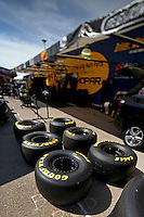 Apr. 5, 2013; Las Vegas, NV, USA: (Editors note: Special effects lens used in creation of this image) Goodyear tires for NHRA funny car driver Matt Hagan in the pits during qualifying for the Summitracing.com Nationals at the Strip at Las Vegas Motor Speedway. Mandatory Credit: Mark J. Rebilas-
