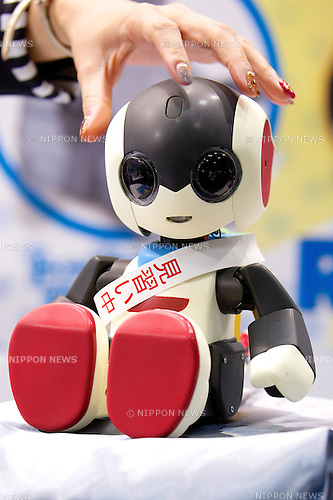 """The robot of Takara Tomy """"Robi"""" can speak 1000 Japanese phrases to respond to human voice at the Japan Robot Week 2014 on October 16, 2014 in Tokyo, Japan. Companies at the """"Japan Robot Week 2014"""" exhibited their latest high-tech nursing and life supporting robots. The 2014 edition of the show ran from October 15 to 19 at Tokyo Big Sight. (Photo by Rodrigo Reyes Marin/AFLO)"""