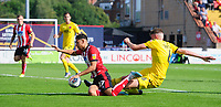 Lincoln City's Tyler Walker vies for possession with Fleetwood Town's Harry Souttar<br /> <br /> Photographer Chris Vaughan/CameraSport<br /> <br /> The EFL Sky Bet League One - Lincoln City v Fleetwood Town - Saturday 31st August 2019 - Sincil Bank - Lincoln<br /> <br /> World Copyright © 2019 CameraSport. All rights reserved. 43 Linden Ave. Countesthorpe. Leicester. England. LE8 5PG - Tel: +44 (0) 116 277 4147 - admin@camerasport.com - www.camerasport.com