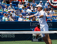 Tomas Berdych hits a volley during the Legg Mason Tennis Classic at the William H.G. FitzGerald Tennis Center in Washington, DC.  Mardy Fish and Mark Knowles defeated Tomas Berdych and Radek Stepanek in the doubles final on Sunday afternoon.