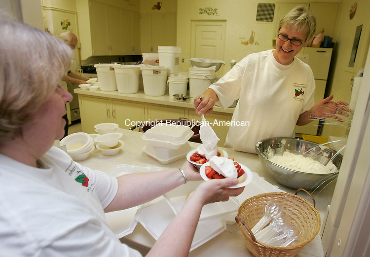 MIDDLEBURY, CT -15 June 2005 -061505BZ02- Maria Ryan, of Middlebury, left, and Donna Hine, of Woodbury, prepare strawberry shortcake for customers during the annual Strawberry Festival in Middlebury Wednesday night.  <br />  Jamison C. Bazinet Photo