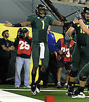 10/02/10-- Oregon quarterback Darron Thomas raises arms after scoring a touchdown against Stanford at Autzen Stadium in Eugene, Or..Photo by Jaime Valdez......