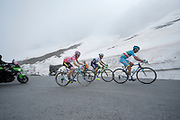 The 3 main GC-contenders for the 2016 Giro still together up the snow-covered Colle dell'Agnello (2744m): Vincenzo Nibali (ITA/Astana), Johan Esteban Chaves (COL/Orica-GreenEDGE) & Steven Kruijswijk (NLD/LottoNL-Jumbo)<br /> <br /> A few kilometers beyond this point Maglia Rosa Kruijswijk would crash & the cards would be re-shuffled...<br /> <br /> stage 19: Pinerolo(IT) - Risoul(FR) 162km<br /> 99th Giro d'Italia 2016