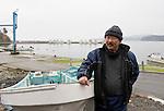 Fisherman Toshikazu Takahashi stands by a salvaged fishing boat in Kyubunhama, Ishinomaki, Miyagi Prefecture, JapanPhotographer: Robert Gilhooly