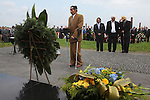"""Laying wreaths at the 67th Anniversary. Memorial to murdered Roma and Sinti in the concentration camp at the so-called Zigeunerlager, the concentration camp hut for Roma and Sinti. Auschwitz II Birkenau, Oswiecim Poland ..Roma Holocaust """"Porrajmos"""", the Roma word means literally """"the devouring"""", where it is estimated that between 500 thousand and one and a half million Roma were exterminated across Germany, Poland, ex-Yugoslavia and Czechoslovakia during the 1930s and 1940s. The Roma were the first race to be subjected to experimentation by the Nazis, as part of Joseph Goebbels' 'Final Solution'."""