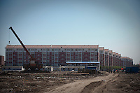 Daytime landscape view of a Suburban Low Rise Residential Development under construction in Tianjin, China.  © LAN