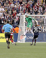 New England Revolution goalkeeper Preston Burpo (24) uses a header to deflect a shot at goal with New England Revolution defender Darrius Barnes (25) in support.  to safety The New England Revolution drew FC Dallas 1-1, at Gillette Stadium on May 1, 2010