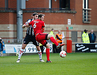 Leyton Orient's Tom Parkes fends off Grimsby Town's Shaun Pearson during the Sky Bet League 2 match between Leyton Orient and Grimsby Town at the Matchroom Stadium, London, England on 11 March 2017. Photo by Carlton Myrie / PRiME Media Images.