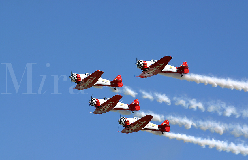The Aeroshell demonstration team soars overhead in the blue skies of the Dayton Airshow
