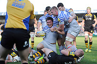 Jamie George of Saracens is congratulated by team mates after scoring a late try during the Aviva Premiership match between London Wasps and Saracens at Adams Park on Saturday 29th March 2014 (Photo by Rob Munro)