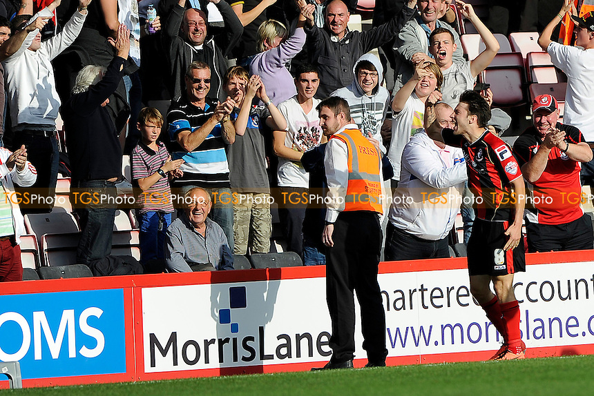 Harry Arter of AFC Bournemouth celebrates with the home fans after scoring - AFC Bournemouth vs Millwall - Sky Bet Championship Football at the Goldsands Stadium, Bournemouth, Dorset - 05/10/13 - MANDATORY CREDIT: Denis Murphy/TGSPHOTO - Self billing applies where appropriate - 0845 094 6026 - contact@tgsphoto.co.uk - NO UNPAID USE
