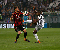 Manuel Locatelli and Douglas Costa of Juventus  during the  Coppa Italia ( Tim Cup) final soccer match,  Ac Milan  - Juventus Fc       at  the Stadio Olimpico in Rome  Italy , 09 May 2018