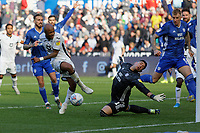 Andre Ayew of Swansea City (L) has his shot blocked by Neil Etheridge of Cardiff City (R) during the Sky Bet Championship match between Swansea City and Cardiff City at the Liberty Stadium, Swansea, Wales, UK. Sunday 27 October 2019