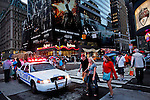 A New York Police Department car patrols the streets of Times Square after NYPD increased security at movie theaters after 'Dark Knight Rises' premier in New York, July 20, 2012.  Photo by Eduardo Munoz Alvarez / VIEW.
