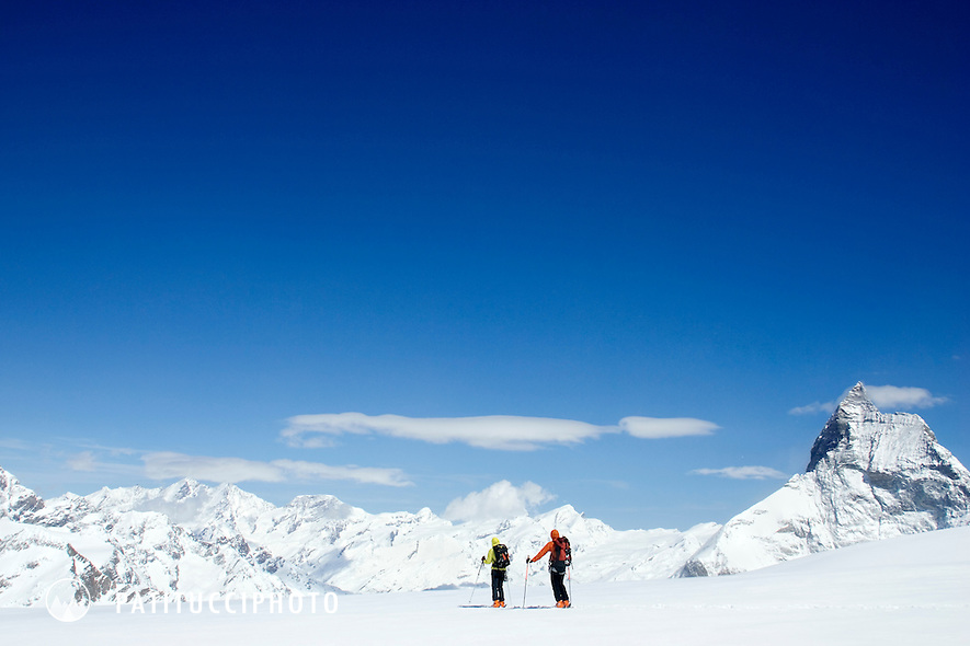 Two ski tourers on the Haute Route nearing the Matterhorn. Zermatt, Switzerland