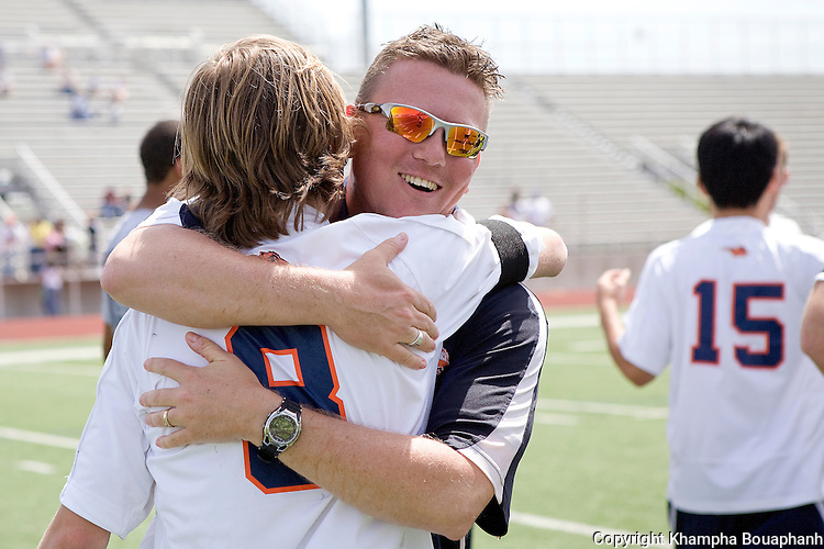 Frisco Wakeland's head coach Rusty Oglesby gives senior Jimmy Irwin a hug after their 2-0 victory over Kilgore in a region II 4A boys high school soccer in Carrollton on April 3, 2010.  (photo by Khampha Bouaphanh)