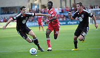 Chicago Fire forward Patrick Nyarko (14) races for the ball against DC United defenders Dejan Jakovic (5) and Devon McTavish (18).  The Chicago Fire tied DC United 0-0 at Toyota Park in Bridgeview, IL on Oct. 16, 2010.