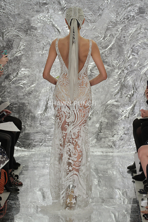 """Model Shin Yang walks runway in Venus - a white crystal and sequin """"Star Light"""" embroidered bridal gown, from the Theia Spring 2017 bridal collection by Don O'Neill, during New York Bridal Fashion Week Spring Summer 2017 on April 14, 2016."""