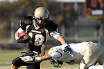 Palos Verdes, CA 10/30/09 - Austin Smith (#18) tries to push away a Mira Costa defender during the Peninsula-Mira Costa football game.