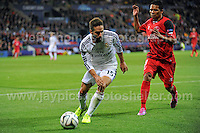 Cardiff City Stadium, Cardiff, South Wales - Tuesday 12th Aug 2014 - UEFA Super Cup Final - Real Madrid v Sevilla - <br /> <br /> Real Madrid&rsquo;s Daniel Carvajal and Sevilla&rsquo;s Carlos Bacca in action during the game. <br /> <br /> <br /> <br /> <br /> Photo by Jeff Thomas/Jeff Thomas Photography