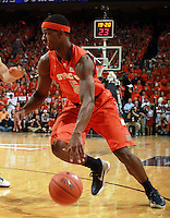 Syracuse forward C.J. Fair (5) handles the ball during an NCAA basketball game Saturday March 1, 2014 in Charlottesville, VA. Virginia defeated Syracuse 75-56.