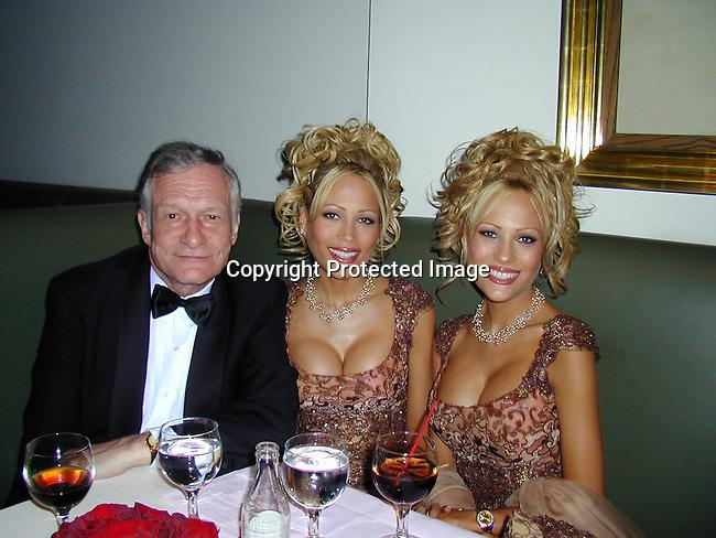 Hugh Hefner with  Sandy &amp; Mandy Bentley<br />2000 Vanity Fair Post Oscar Party<br />Morton's Restaurant<br />Los Angeles, California, USA<br />March 26, 2000<br />Photo by Celebrityvibe.com