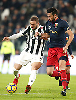 Calcio, Serie A: Juventus - Genoa, Torino, Allianz Stadium, 22 gennaio 2018. <br /> Juventus' Gonzalo Higuain (l) in action with Genoa's Nicolas Spolli (r) during the Italian Serie A football match between Juventus and Genoa at Torino's Allianz stadium, January 22, 2018.<br /> UPDATE IMAGES PRESS/Isabella Bonotto