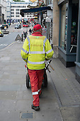 City of London street cleaner employed by private contractor Enterprise.