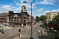 A view over a cordoned area where rioting took place two nights earlier in Tottenham, London borough of Haringey, with a completely burnt out building. London saw the beginnings of riots on Saturday evening, after a peaceful protest in response to the shooting by police of Mark Duggan during an attempted arrest, escalated into violence. By the third night of violence, rioting had spread to many areas of the capital and to other cities around the country.