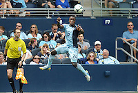 Mechack Jerome (24) defender Sporting KC keeps the ball in play..Sporting Kansas City and Houston Dynamo played to a 1-1 tie at Sporting Park, Kansas City, Kansas.