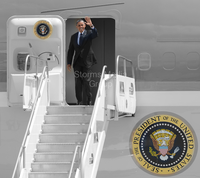 SMG_President Barack Obama_FLXX_Arrival_092012_11.JPG<br /> <br /> MIAMI, FL - SEPTEMBER 20: US President Barack Obama can't open his eyes in the bright Florida sun as he arrives on Air Force One on a hot sunny Florida day at Miami International Airport.  The  President is in Florida to participate in a taping for Univision in Miami before attending a campaign event in Tampa.  on September 20, 2012 in Miami, Florida. (Photo By Storms Media Group)  <br /> <br /> People:  President Barack Obama<br /> <br /> Transmission Ref:  FLXX<br /> <br /> Must call if interested<br /> Michael Storms<br /> Storms Media Group Inc.<br /> 305-632-3400 - Cell<br /> 305-513-5783 - Fax<br /> MikeStorm@aol.com