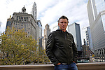 Denis Brogniart, host of French Survivor television show, stands on Michigan Avenue by the Chicago River a day ahead of the Chicago Marathon in Chicago, Illinois on October 10, 2009.