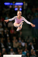 September 9, 2007; Stuttgart, Germany;  Anastasia Liukin of USA performs cossack jump on balance beam during event finals in women's artistic gymnastics at 2007 World Championships.  Photo by Copyright 2007 by Tom Theobald.