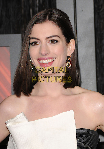 ANNE HATHAWAY.The 14th Annual Critics Choice Awards held at The Santa Monica Civic Center in Santa Monica, California, USA. .January 8th, 2009.headshot portrait gold earrings black white strapless .CAP/DVS.©Debbie VanStory/Capital Pictures.