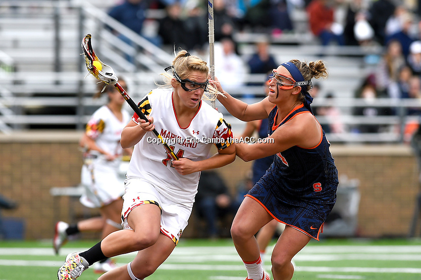 Maryland's Brooke Griffin (11) works against Syracuse's Kasey Mock (14)  during the 2014 ACC Women's Lacrosse Championship in Boston, MA, Sunday, April 27, 2014. (Photo by Eric Canha,<br /> theACC.com)
