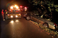 A tow truck tows a car out of a ditch after a vehicle accident