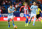 Antoine Griezmann (r) of Atletico de Madrid battles for the ball with Jonathan Castro Otto, Jonny, of RC Celta de Vigo during their La Liga match between Atletico de Madrid and RC Celta de Vigo at the Vicente Calderón Stadium on 12 February 2017 in Madrid, Spain. Photo by Diego Gonzalez Souto / Power Sport Images