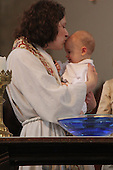 Rockefeller Chapel celebrated Mother's Day with service, African music sung by the Rockefeller Chapel Children's Choir and even a baptism.<br /> <br /> Noah Robert Tryon was baptised by Bromleigh McCleneghan as his grandmother Joyce Tryon and mother Jennifer Tryon stood by.