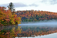The morning sun hitting a nearby hillside during the autumn season. Marquette County - Upper Peninsula MI